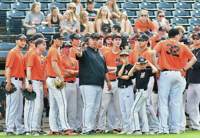 Minster coach Mike Wiss talks with his team before a Division IV state semifinal against Jeromesville Hillsdale on Friday at Canal Park in Akron.