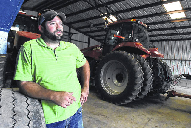 Area farmer Ben Bowser with his farm equipment in Harrod. He decided to plant soybeans after the weather interfered with the usual corn-planting schedules.