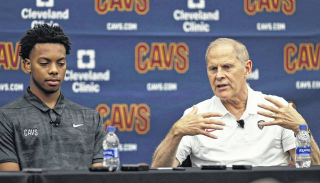 Cleveland Cavaliers head coach John Beilein, right, answers questions as Darius Garland listens, Friday, June 21, 2019, in Independence, Ohio. The Cavaliers selected Garland with the No. 5 overall pick Thursday night despite the point guard playing in five games at Vanderbilt before injuring his left knee. Garland was always on Cleveland's radar, but they became convinced that he was the right choice during a private workout last week in Los Angeles. (AP Photo/Tony Dejak)