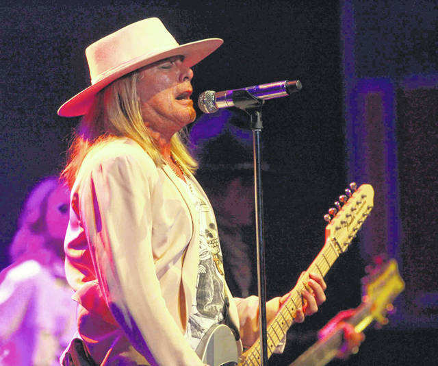 Cheap Trick's lead singer, Robin Zander, gets the crowd going while performing one of the band's hits Wednesday during a performance at Veterans Memorial Civic Center's Crouse Performing Arts Center.