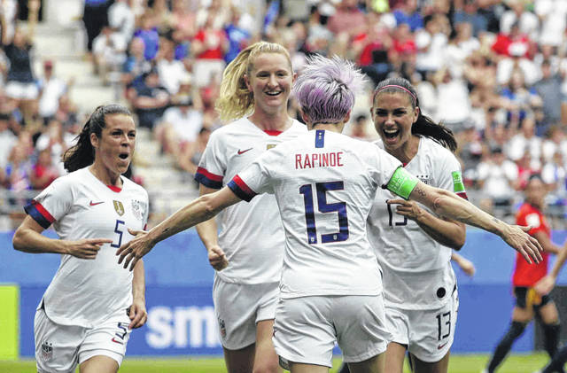 United States' Megan Rapinoe, front, celebrates with teammates after scoring the opening goal from a penalty kick during the Women's World Cup round of 16 soccer match between Spain and US at the Stade Auguste-Delaune in Reims, France, Monday.