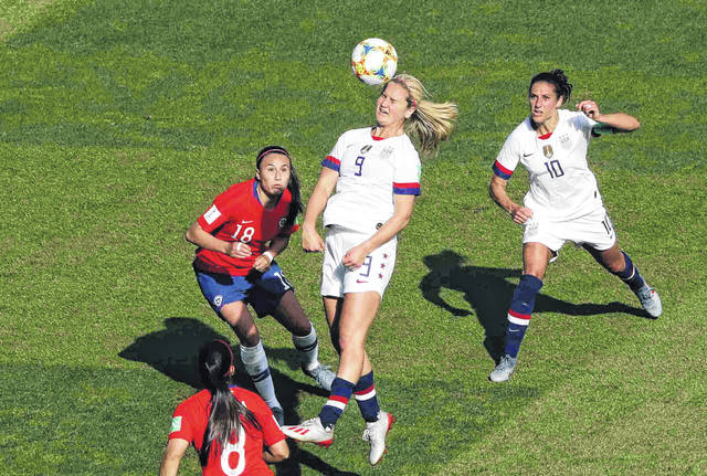 United States' Lindsey Horan, center, heads the ball during the Women's World Cup Group F soccer match between the United States and Chile at the Parc des Princes in Paris, Sunday, June 16, 2019. (AP Photo/Thibault Camus)