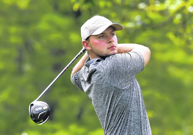 Aaron Belcher watches his tee shot on the 12 hole during Championship Flight play Thursday at Colonial Golfers Club.
