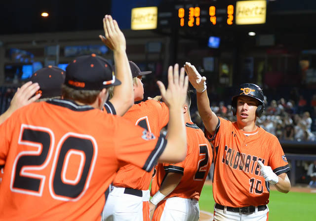 Coldwater's Jacob Wenning, right, celebrate with teammates after scoring against Ridgewood during Sunday's Division III State Championship game at Canal Park in Akron.