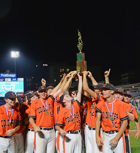Coldwater players celebrate with the team trophy after winning Sunday's Division III State Championship game against Ridgewood at Canal Park in Akron.