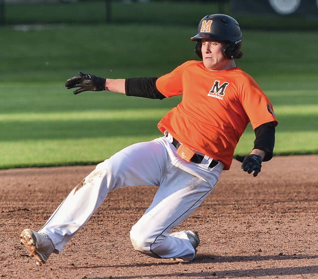 Minster's Jack Olberding, here sliding into third base during the Coldwater Division IV district final against New Bremen in May, enters today's state semifinal against Jeromesville Hillsdale with a .444 batting average, 31 RBI and 38 runs.