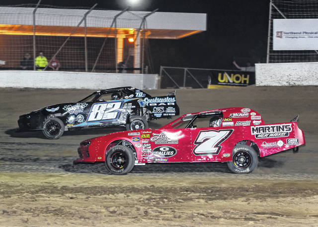 Jordan Conover (7) passes Chris Douglas during Friday night's Thunderstock feature at Limaland Motorsports Park.