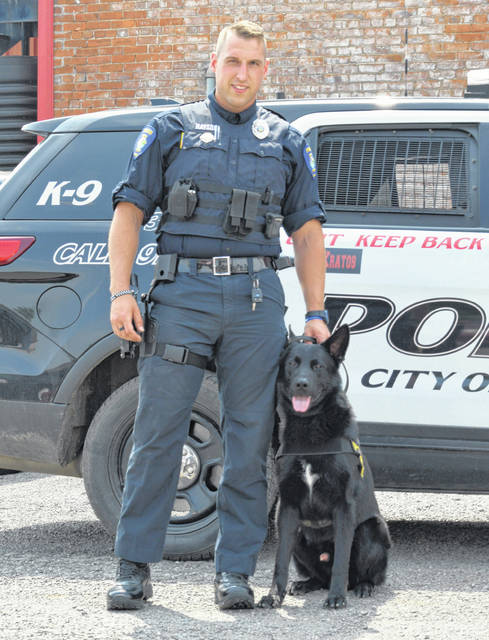 Delphos police officer Tyler Hayson poses with K9 Kratos.