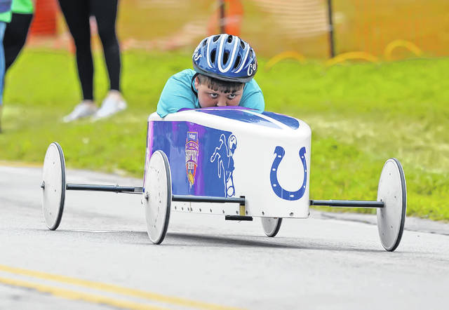 Connor Truex heads down the track during Saturday's Soap Box Derby on the Henry J. Hawk Memorial Hill in Faurot Park.