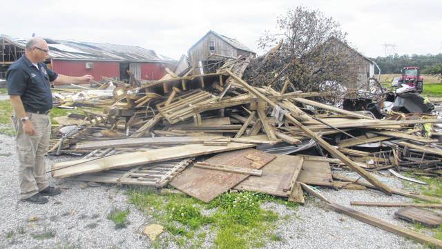 Troy Anderson, Auglaize County Office of Homeland Security and Emergency Management, assessed a home and barn that was deemed damaged from a tornado at 10140 CR33A.