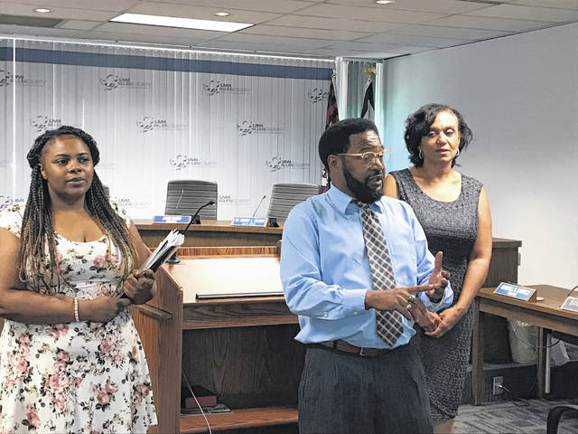 Lima City Councilor Derry Glenn, center, describes the challenges youth with criminal records face when seeking employment in Lima. Glenn was joined by Iyisha Russell, left, and Tosca Spencer, in advocating for more flexibility in who is eligible to have their records expunged.