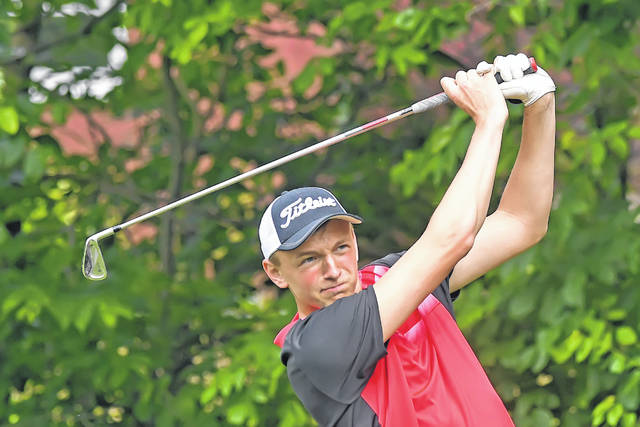 Christian Nartker tees off during Tuesday's Cappie Sportswear Open at Springbrook Golf Club.