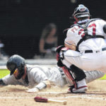 Bradley delivers, Indians sweep Tigers