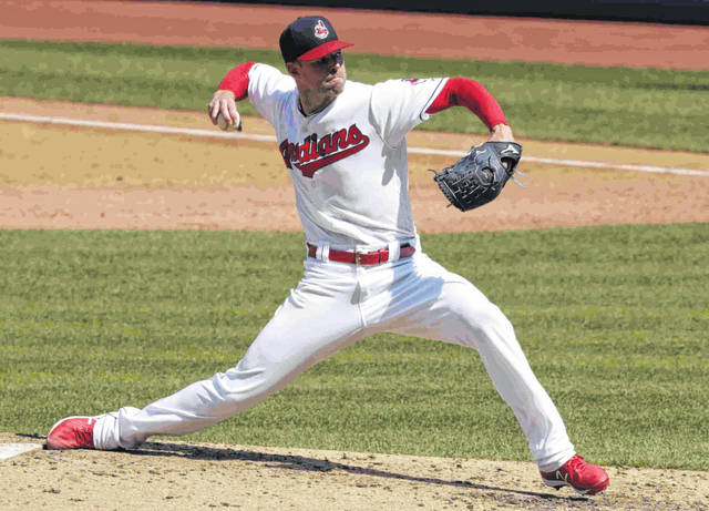 FILE - In this Sept. 5, 2018, file photo, Cleveland Indians starting pitcher Corey Kluber delivers in the sixth inning of a baseball game against the Kansas City Royals, in Cleveland. Hours before the first pitch of Sunday's series finale against the New York Yankees, two-time Cy Young winner Corey Kluber ran sprints across the sun-soaked outfield inside an empty Progressive Field. Each time he finished a loop around two neon discs, Kluber checked a stopwatch to make sure he was hitting his marks. In a day or two, his broken right arm will be re-evaluated to see if he can pitch for Cleveland again this season. (AP Photo/Tony Dejak, File)