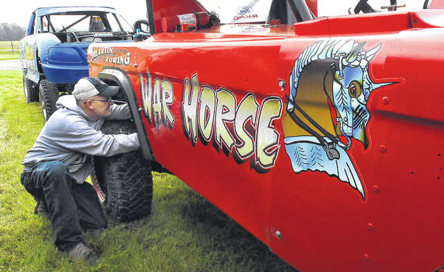 """Mike Lupold, of Apalachin, New York, makes adjustments to his 1975 4x4 Ford F-150 named """"War Horse"""" modified for """"Tough Truck"""" category in the 34th Annual O'Reilly Auto Parts 4-Wheel Jamboree Nationals in Lima at the Allen County Fairgrounds this weekend. The Lima 4-Wheel Jamboree Nationals brings together 4X4 and off-road enthusiasts from coast-to-coast, in addition to thousands of trucks and Jeep vehicles, along with leading parts manufacturers and off-road racers from across the country."""
