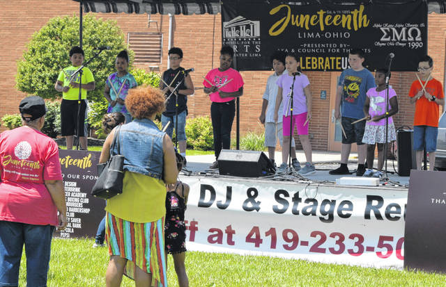 Heritage Harmonics perform on the stage at Dr. Martin Luther King Jr. Center Park as part of the Juneteenth celebration Saturday.