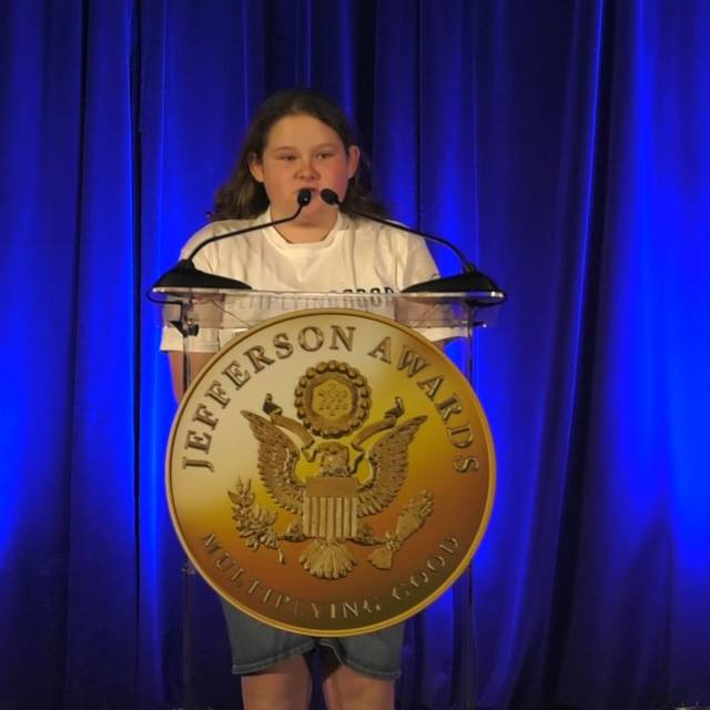 Lauren Cunningham, 14, of Lima, speaks about blood drives to help the community during her speech at the Jefferson Awards in Washington, D.C., on Tuesday.