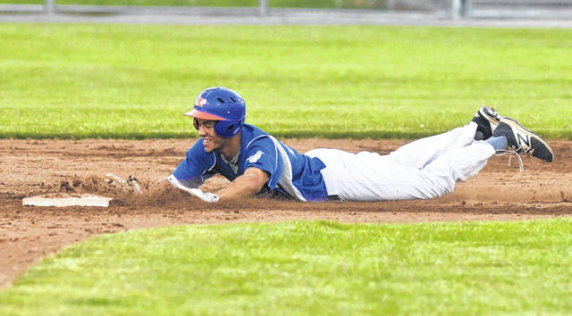 The Lima Locos' Lavoisier Fisher slides into second with a double during Wednesday night's game against the Grand Lake Mariners at Simmons Field.