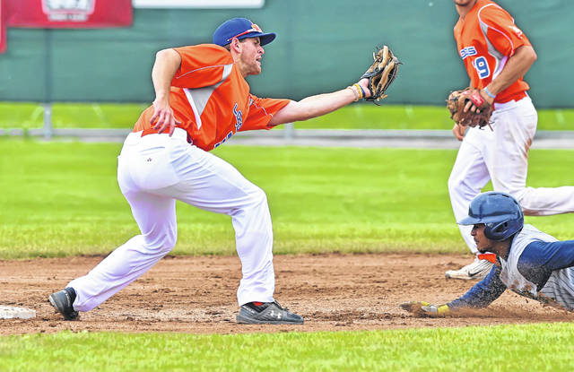 Lima Locos' Jacob Pennington tags out Michigan Monarchs' Jordan Rogers at second base during Sunday's game at Simmons Field.