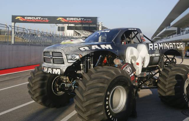 RAMINATOR driver Mark Hall prepares to attempt setting a new GUINNESS WORLD RECORDS  record for Fastest Speed for a Monster Truck at Circuit of the Americas Speedway, on Monday, Dec. 15, 2014 in Austin, Texas. Hall reached a speed of 99.1 mph to break the 2012 record of 96.8 mph. (Photo by Jack Plunkett/Invision for Ram Truck brand, Chrysler Fiat Automobiles/AP Images)