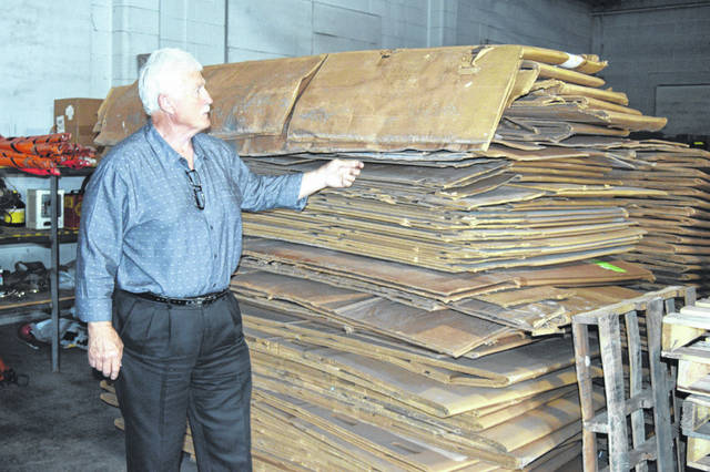 Jack DeWitt, with the North Central Ohio Solid Waste District, looks over the piles of cardboard used to ship out recyclables from its facility in Lima.