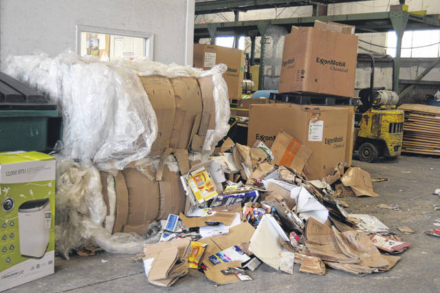 Paper, cardboard and plastics await recycling at the Auglaize County Solid Waste District office, north of St. Marys.