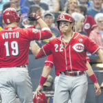 Reds settle for split with Brewers