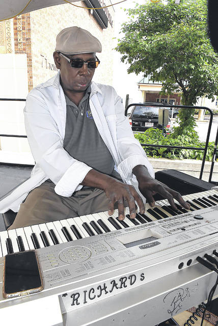 Richard Commons performs in Lima's Town Square on Wednesday. Commons performs 11 a.m. to 1 p.m. Wednesdays this summer in front of ArtSpace/Lima.