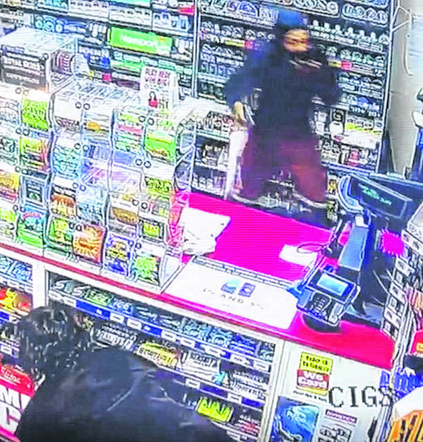 Surveillance video captured a robbery in progress at the Bluelick Road Clark gas station in Lima in May.
