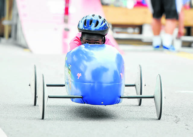 Izaiah Thompson competes in Saturday's Soap Box Derby held on the Henry J. Hawk Memorial Hill in Faurot Park.