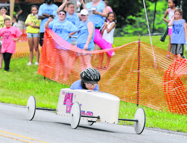 Maddie Skinner competes in Saturday's Soap Box Derby held on the Henry J. Hawk Memorial Hill in Faurot Park. Richard Parrish | The Lima News