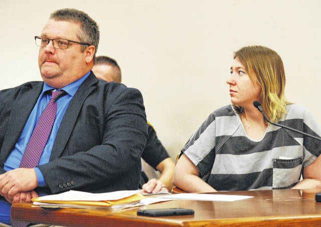 Bobby Spyres, 27, of Lima, turns to look as Ruby Culp, the sister of Larry Money, addresses the judge Thursday during Spyres' sentencing hearing.