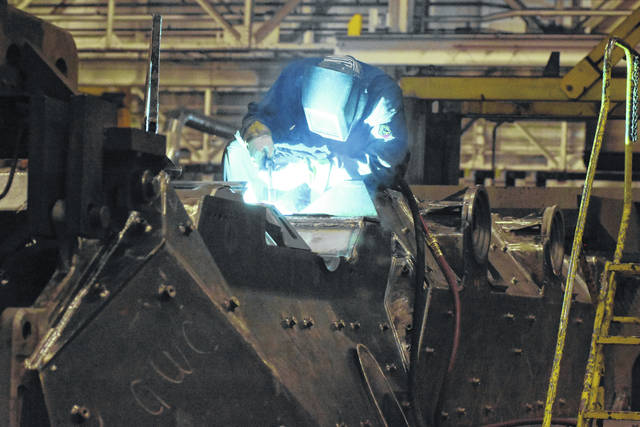 An employee at Joint Systems Manufacturing Center welds at the facility in May. The U.S. Senate approved the National Defense Authorization Act, which includes $1.7 billion in funding to upgrade 165 Abrams tanks.
