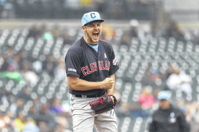 Cleveland Indians pitcher Trevor Bauer reacts to striking out Detroit Tiger's Brandon Dixon in the ninth inning of a baseball game in Detroit, Sunday, June 16, 2019. Cleveland won 8-0. (AP Photo/Paul Sancya)