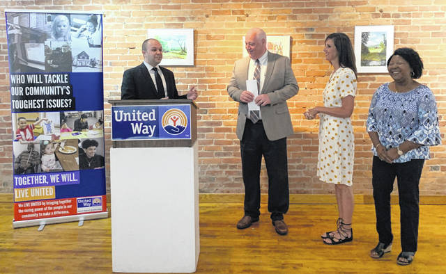 United Way of Greater Lima President and CEO Derek Stemen honors 2018 campaign chairs, from left, Jeff Fitzgerald, Brenda Burgy and Ann Miles at a celebration Thursday at ArtSpace/Lima.