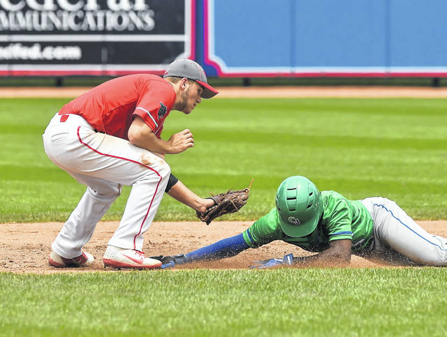 Van Wert's Jake Lautzenheiser tags out Chaminade-Julienne's AJ Solomon during a Saturday Division II state semifinal at Canal Park in Akron.