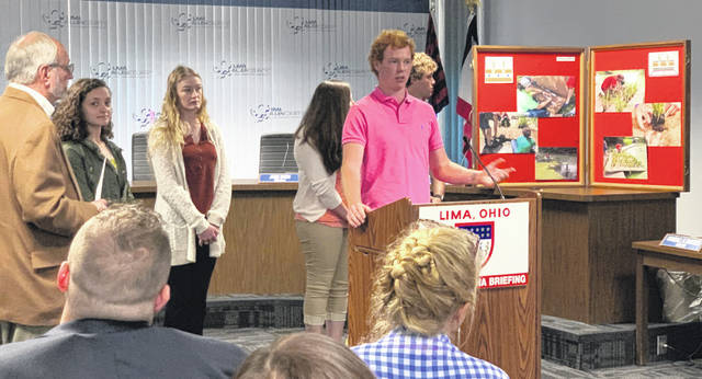 Intern Cooper Wall explains the group's construction and installation of the floating wetlands during Lima Mayor David Berger's weekly press conference Wednesday.