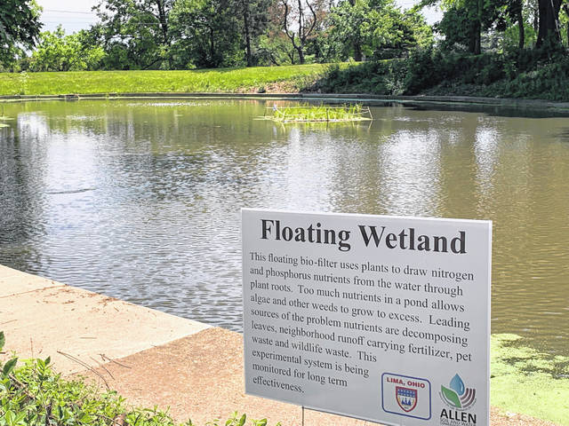 Cemetery and Bear-Pit ponds are marked with signs acknowledging the floating wetlands and their purposes for park-goers at Lima's Faurot Park.