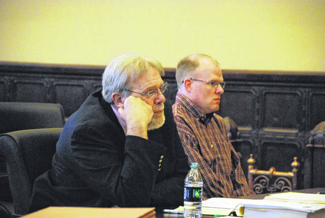 Defense attorney William Kluge, left, and defendant Brent Williams listen during testimony Tuesday in Williams' murder trial in Wapakoneta.