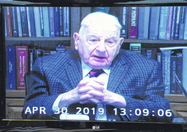 Pathologist Dr. Werner Spitz speaks in a video deposition in the murder case of Brent Williams.