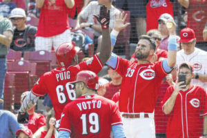 Winker paces Reds with 5 RBIs in 11-3 rout over Rangers