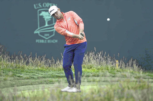 Gary Woodland chips off the 17th green during the final round of the U.S. Open Championship golf tournament Sunday, June 16, 2019, in Pebble Beach, Calif. (AP Photo/Marcio Jose Sanchez)