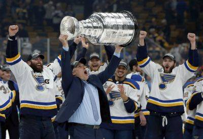 St. Louis Blues head coach Craig Berube hoists the Stanley Cup after the Blues defeated the Boston Bruins in Game 7 of the NHL Stanley Cup Final on Wednesday in Boston. (AP photo)