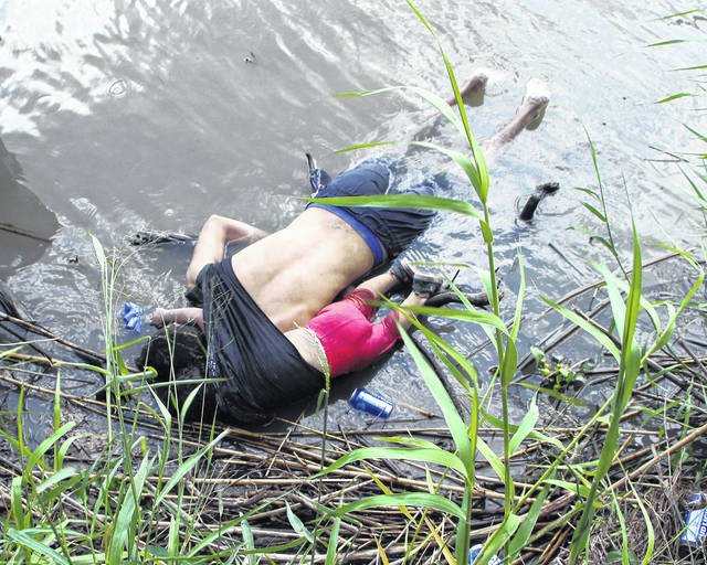 The bodies of Salvadoran migrant Oscar Alberto Martinez Ramirez and his nearly 2-year-old daughter, Valeria, lie on the bank of the Rio Grande in Matamoros, Mexico, on June 24, 2019, after they drowned trying to cross the river to Brownsville, Texas. Martinez' wife, Tania told Mexican authorities she watched her husband and child disappear in the strong current. Oscar Alberto Martinez Ramirez, was frustrated because the family from El Salvador was unable to present themselves to U.S. authorities and request asylum. (Abraham Pineda-Jacome/EFE/Zuma Press/TNS)