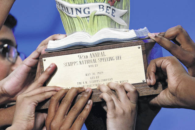 Eight co-champions carry a trophy after winning the 2019 Scripps National Spelling Bee early Friday. (Yes, we know the headline has spelling issues).