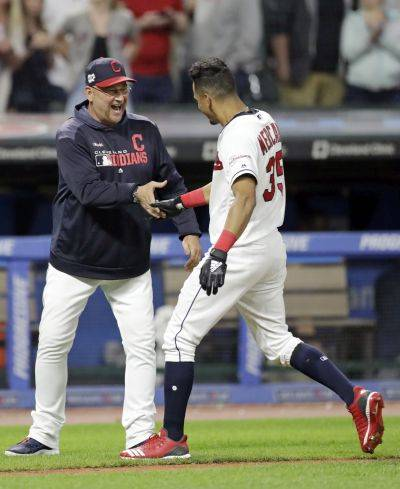 Indians manager Terry Francona, left, congratulates Oscar Mercado after Mercado hit a game winning RBI-single in the 10th inning Tuesday night against Cincinnati in Cleveland.