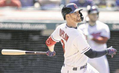 The Indians' Jordan Luplow hits an RBI single during Wednesday's game against Kansas City in Cleveland. (AP photo)