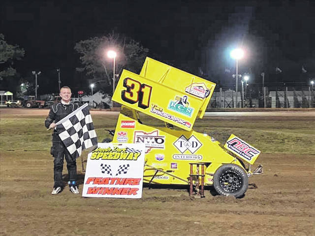 Jac Nickles, a 14-year-old who will be an eighth-grader at Allen East, is seen after becoming the youngest driver to win a Midwest Mini Sprint Association feature event.