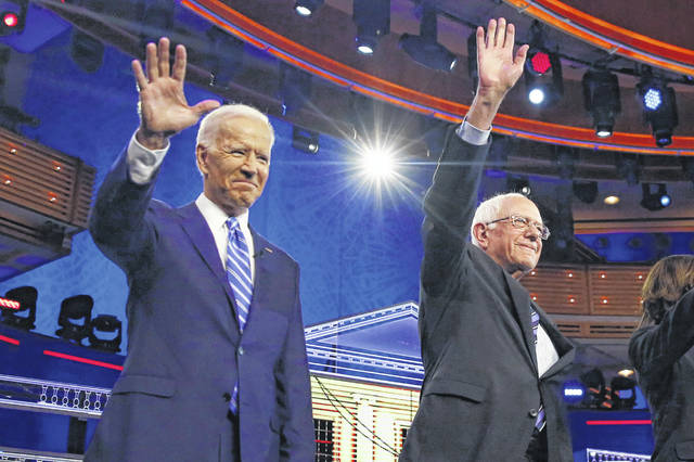 Joe Biden, left, and Bernie Sanders hoped to determine the direction of the Democratic Party during Thursday's debate. (AP Photo/Brynn Anderson)