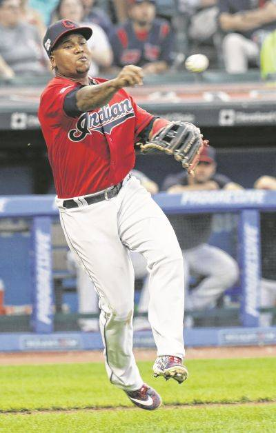 The Indians' Jose Ramirez throws out Kansas City's Nicky Lopez at first base during Tuesday night's game in Cleveland.